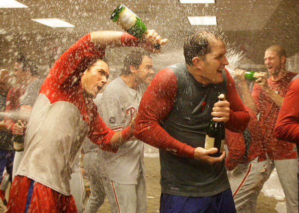 The Philadelphia Phillies celebrate in their clubhouse after sweeping the Cincinnati Reds with a 2-0 win in Game 3 of baseball&#39;s National League Division Series Sunday, Oct. 10, 2010, in Cincinnati. <span class=meta>(AP Photo&#47;Al Behrman)</span>