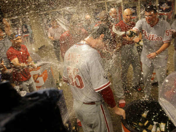 Philadelphia Phillies starting pitcher Cole Hamels gets sprayed with champagne in the clubhouse after his 2-0, complete game win over the Cincinnati Reds in Game 3 of baseball&#39;s National League Division Series Sunday, Oct. 10, 2010, in Cincinnati.  <span class=meta>(AP Photo&#47;Al Behrman)</span>