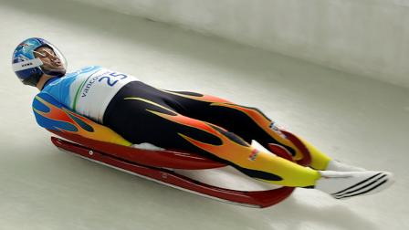 Tony Benshoof of the United States speeds down the course during a mens singles luge training run at the Vancouver 2010 Olympics in Whistler, British Columbia, Saturday, Feb. 13, 2010. (AP Photo/Charlie Krupa)