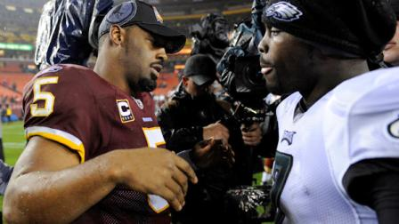 Washington Redskins quarterback Donovan McNabb, left, greets Philadelphia Eagles quarterback Michael Vick after the Eagles defeated the Redskins 59-28 in an NFL football game, Monday, Nov. 15, 2010, in Landover, Md. (AP Photo/Nick Wass)
