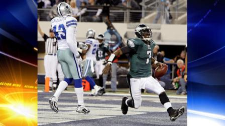 Philadelphia Eagles Michael Vick (7) scores a touchdown as Dallas Cowboys Gerald Sensabaugh reacts during the first half of an NFL football game, Sunday, Dec. 12, 2010, in Arlington, Texas. (AP Photo/Tony Gutierrez)
