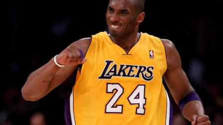 Los Angeles Lakers Kobe Bryant celebrates after making a three-point basket against the San Antonio Spurs during the second half of an NBA basketball game in Los Angeles, Tuesday, April 12, 2011. (AP Photo/Chris Carlson)