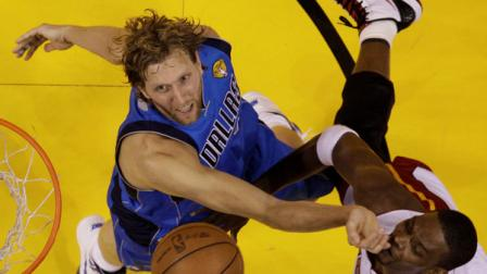 Dallas Mavericks Dirk Nowitzki battles for a rebound with Miami Heats Chris Bosh during the first half of Game 6 of the NBA Finals basketball game Sunday, June 12, 2011, in Miami. (AP Photo/David J. Phillip; Pool)