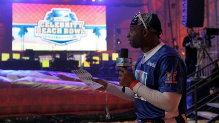 Former football player Deion Sanders does an interview before the Celebrity Beach Bowl, part of NFL footballs Super Bowl XLVI festivities, Saturday, Feb. 4, 2012, in Indianapolis.  (AP Photo/Jeff Roberson)