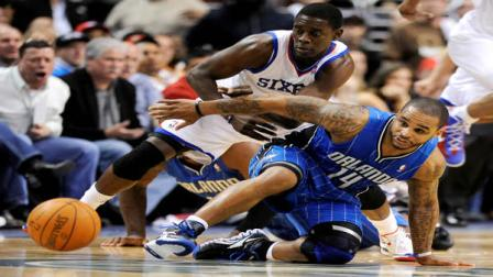 Philadelphia 76ers Jrue Holiday (11) and Orlando Magics Jameer Nelson (14) chase down a loose ball in the second half of an NBA basketball game, Saturday, April 7, 2012, in Philadelphia. The Magic won 88-82. (AP Photo/Michael Perez)