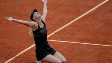 Russias Maria Sharapova reacts as she defeats Italys Sara Errani in their womens final match in the French Open tennis tournament at the Roland Garros stadium in Paris, Saturday, June 9, 2012. Sharapova won 6-3, 6-2. (AP Photo/Michel Spingler)