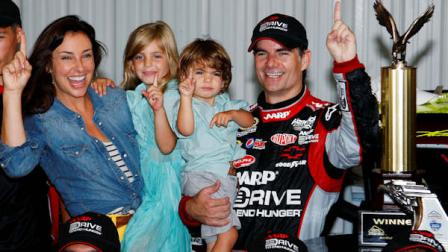 Jeff Gordon celebrates in victory lane with his wife Ingrid Vandebosch, daughter Ella Sofia and son Leo Benjamin after winning the NASCAR Sprint Cup Series auto race, Sunday, Aug. 5, 2012, at Pocono Raceway in Long Pond, Pa. (AP Photo/LAT, Lesley Ann Miller) MANDATORY CREDIT