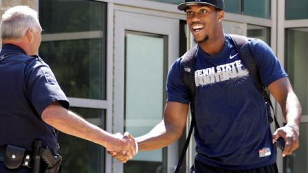Penn State University football wide receiver Justin Brown, right, leaves the Lasch Football building after a team meetings explaining the ramifications of the NCAA sanctions against the Penn State University football program in State College, Pa., Monday, July 23, 2012. (AP Photo/Gene J. Puskar)