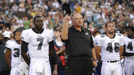 Philadelphia Eagles Michael Vick and coach Andy Reid stand on the sideline during a moment of silence for Reids son Garrett, who died Sunday, before an NFL preseason football game against the Pittsburgh Steelers, Thursday, Aug. 9, 2012, in Philadelphia. (AP Photo/Michael Perez)