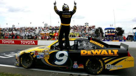 Marcos Ambrose stands on his car as he celebrates his win at the NASCAR Sprint Cup Series auto race at Watkins Glen International, Sunday, Aug. 12, 2012, in Watkins Glen, N.Y. (AP Photo/Autostock, Russell LaBounty)