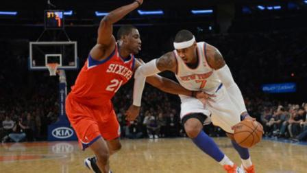 New York Knicks Carmelo Anthony, right, drives on the Philadelphia 76ers Thaddeus Young in the first quarter of the NBA basketball game at Madison Square Garden in New York, Sunday, Nov. 4, 2012. (AP Photo/Henny Ray Abrams)