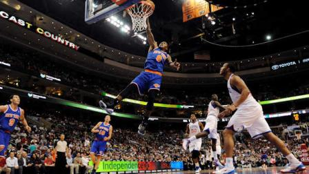 New York Knicks J.R. Smith (8) dunks on a fast break in the second half of an NBA basketball game against the Philadelphia 76ers on Monday, Nov. 5, 2012, in Philadelphia. The Knicks won 110-88. (AP Photo/Michael Perez)