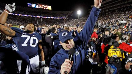 FILE - In this Nov. 24, 2012, file photo, Penn State head coach Bill OBrien, center, celebrates with his team after their 24-21 overtime win over Wisconsin in an NCAA college football game in State College, Pa.  (AP Photo/Gene J. Puskar, File)
