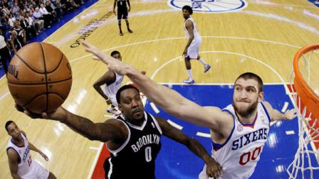 Brooklyn Nets Andray Blatche (0) shoots against Philadelphia 76ers Spencer Hawes (00) in the first half of an NBA basketball game, Tuesday, Jan. 8, 2013, in Philadelphia. (AP Photo/Matt Slocum)