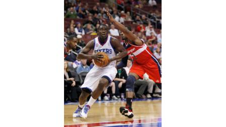 Washington Wizards John Wall (2) defends as Philadelphia 76ers Jrue Holiday drives into the lane during the first half of an NBA basketball game Wednesday, Jan. 30, 2013, in Philadelphia. (AP Photo H. Rumph Jr)