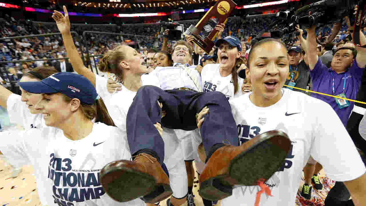 Connecticut players celebrate as they carry their head coach Geno Auriemma after defeating Louisville 93-60 in the national championship game of the womens Final Four of the NCAA college basketball tournament, Tuesday, April 9, 2013, in New Orleans.