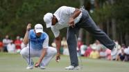 In this photo made May 11, 2013, Tiger Woods, right, and Sergio Garcia of Spain are shown on the 12th green during the third round of The Players championship golf tournament at TPC Sawgrass in Ponte Vedra Beach, Fla. Garcia apologized to Woods on Wednesday, May 22, 2013, for saying he would have fried chicken at dinner with his rival, a comment that Woods described as hurtful and inappropriate. (AP Photo/Gerald Herbert)