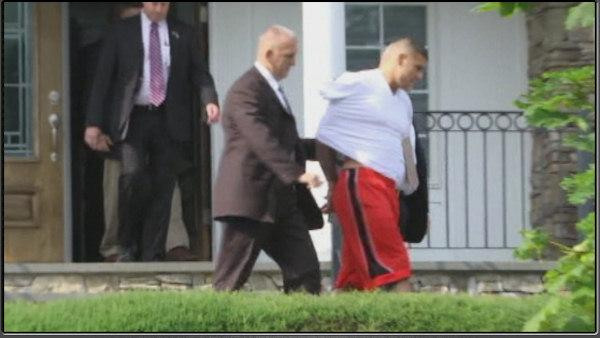 Pictures of Aaron Hernandez in handcuffs