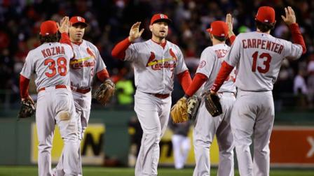 St. Louis Cardinals players celebrate after defeating the Boston Red Sox, 4-2, in Game 2 of baseballs World Series Thursday, Oct. 24, 2013, in Boston. The series is tied at 1-1. (AP Photo/Matt Slocum)
