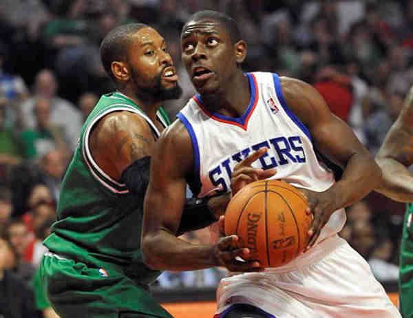 Philadelphia 76ers guard Jrue Holiday, right, drives on Chicago Bulls guard C.J. Watson during the first quarter of an NBA basketball game, Saturday, March 17, 2012, in Chicago. The Bulls won 89-80. (AP Photo/Brian Kersey)