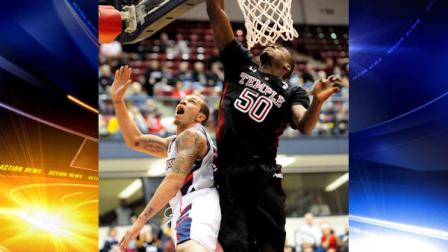 Duquesne s Bill Clark has a shot blocked by Temples Michael Eric, right, in the first half of an NCAA college basketball game in Pittsburgh, Saturday, Jan. 15, 2011. Duquesne limited No. 19 Temple to 31 percent shooting in winning its sixth consecutive game, 78-66 on Saturday. Clark scored 22 points. (AP Photo/John Heller)