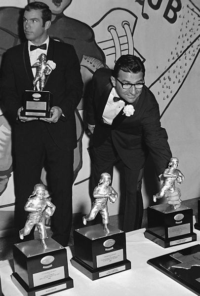 Joe Paterno, who turned down a &#36;70,000 pact to coach the Pittsburgh Steelers, picks his trophy as he was honored as the outstanding college coach by the Touchdown Club of Washington on Jan. 11, 1969. Paterno guided Penn state to its first unbeaten season in years and an orange bowl win over Kansas.  <span class=meta>(AP Photo&#47;RH)</span>