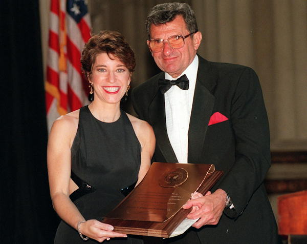 Penn State University head football coach Joe Paterno poses with Carolyn Presutti, an anchor from WUSA-TV in Washington, after he was presented with the National Education and Leadership Award by The Sons of Italy Foundation Thursday, May 2, 1996 in Washington.  <span class=meta>(AP Photo&#47;Robert Giroux)</span>
