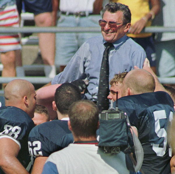 Penn State&#39;s coach Joe Paterno is carried from the field after beating Bowling Green 48-3, Saturday, Sept.12, 1998, in State College, Pa. Paterno, 71, found himself in the most elite group of college coaches by being the sixth in NCAA history, and just the fourth major-college coach, to reach 300 victories.  <span class=meta>(AP Photo&#47; Chris Gardner)</span>