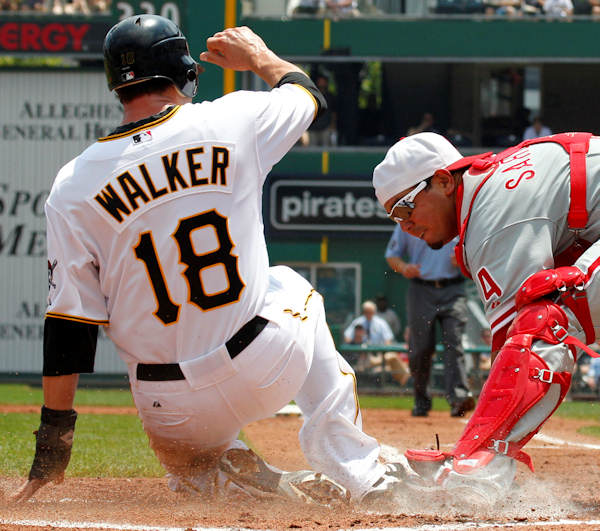Pittsburgh Pirates&#39; Neil Walker &#40;18&#41; scores ahead of the tag by Philadelphia Phillies catcher Dane Sardinha, right, in the first inning of a baseball game in Pittsburgh Sunday, July 4, 2010. Walker scored on a single to right field by Pirates&#39; Pedro Alvarez. &#40;AP Photo&#47;Gene J. Puskar&#41;   <span class=meta>(&#40;AP PHOTO&#41;)</span>