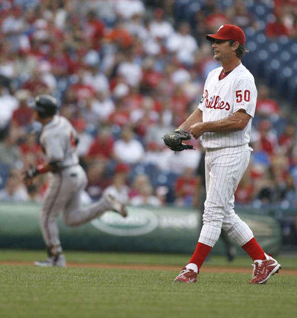 Philadelphia Phillies starting pitcher Jamie Moyer walks back to the mound after Atlanta Braves&#39; Martin Prado, background hit a solo home run in the first inning of a baseball game Wednesday, July 7, 2010, in Philadelphia.  <span class=meta>(&#40;AP Photo&#47;H. Rumph Jr&#41;)</span>