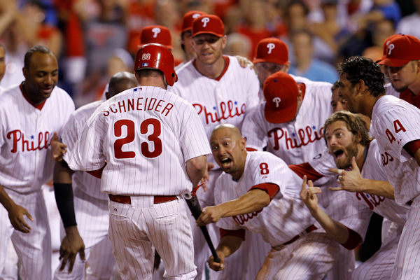 Philadelphia Phillies players celebrate as teammate Brian Schneider &#40;23&#41; crosses home after hitting a game-winning walk off home run off Cincinnati Reds pitcher Jordan Smith in the 12th inning of a baseball game, Thursday, July 8, 2010, in Philadelphia. Philadelphia won 4-3 in 12 innings.  <span class=meta>( &#40;AP Photo&#47;Matt Slocum&#41;)</span>