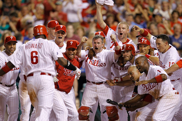 Philadelphia Phillies players wait at home plate for teammate Ryan Howard after his game-winning two-run home run off Cincinnati Reds pitcher Arthur Rhodes in the tenth inning of a baseball game, Friday, July 9, 2010, in Philadelphia. Philadelphia won 9-7 in ten innings. <span class=meta>( &#40;AP Photo&#47;Matt Slocum&#41;  )</span>