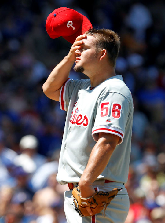 Philadelphia Phillies starter Joe Blanton wipes his face as Chicago Cubs&#39; Ted Lilly walks to first during the fifth inning of a baseball game Friday, July 16, 2010, in Chicago. <span class=meta>(&#40;AP Photo&#47;Nam Y. Huh&#41;  )</span>