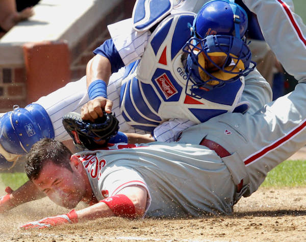 Philadelphia Phillies&#39; Brian Schneider is safe at home as the ball gets away from Chicago Cubs catcher Geovany Soto during the ninth inning of a baseball game Saturday, July 17, 2010 at Wrigley Field in Chicago.The Phillies scored four in the ninth winning 4-1. <span class=meta>( &#40;AP Photo&#47;Charles Rex Arbogast&#41;)</span>
