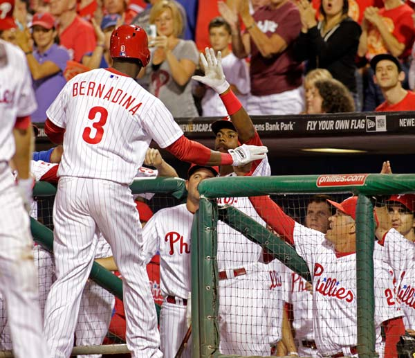 Philadelphia Phillies' Roger Bernadina (3) celebrates with his teammates after he hit a solo home run against the Arizona Diamondbacks in the sixth inning of an MLB National League baseball game Saturday, Aug. 24, 2013, in Philadelphia. The Diamondbacks won the 18-innning game 12-7. (AP Photo/H. Rumph Jr)