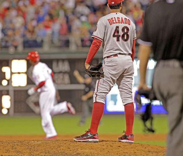 Arizona Diamondbacks starting pitcher Randall Delgado Stands on the mound after Philadelphia Phillies' Roger Bernadina hit a solo home run in the sixth inning of an MLB National League baseball game Saturday, Aug. 24, 2013, in Philadelphia.The diamond backs won 12-7. (AP Photo/H. Rumph Jr)
