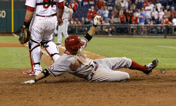 Arizona Diamondbacks' Tony Campana scores against the Philadelphia Phillies in the eighteenth inning of an MLB National League baseball game Saturday, Aug. 24, 2013, in Philadelphia. The Diamondbacks won 12-7 (AP Photo/H. Rumph Jr)