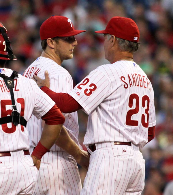 Philadelphia Phillies starting pitcher Ethan Martin gives the ball to manager Ryne Sandberg (23) as he is taken out of the baseball game against the Arizona Diamondbacks in the first inning, Saturday, Aug. 24, 2013, in Philadelphia. (AP Photo/H. Rumph Jr)
