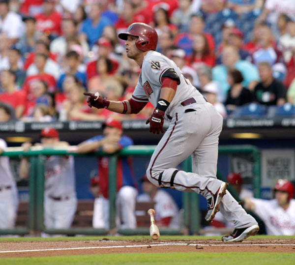 Arizona Diamondbacks' Martin Prado watches his two run home run against the Philadelphia Phillies in the first inning of a baseball game, Saturday, Aug. 24, 2013, in Philadelphia. (AP Photo/H. Rumph Jr)