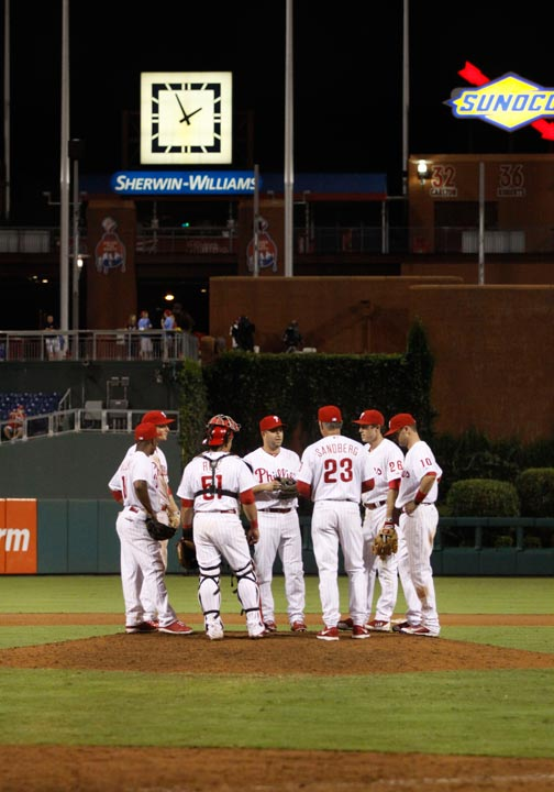 The Philadelphia Phillies meet on the mound as they play against the Arizona Diamondbacks in the eighteenth inning of a baseball game early Sunday, Aug. 25, 2013, in Philadelphia. The Diamondbacks won 12-7. (AP Photo/H. Rumph Jr)