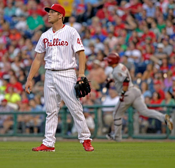 Philadelphia Phillies starting pitcher Ethan Martin stands on the mound after Arizona Diamondbacks' Martin Prado hit a two run home run in the first inning of a baseball game, Saturday, Aug. 24, 2013, in Philadelphia. (AP Photo/H. Rumph Jr)