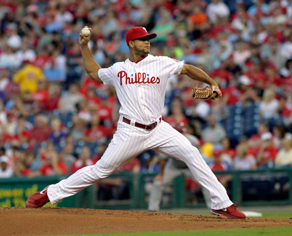 Philadelphia Phillies pitcher Luis Garcla throws against the Arizona Diamondbacks in the first inning of a baseball game, Saturday, Aug. 24, 2013, in Philadelphia. (AP Photo/H. Rumph Jr)