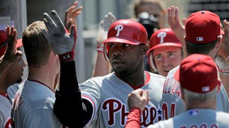 Philadelphia Phillies Ryan Howard is congratulated by teammates after hitting a two-run home run during the sixth inning of a baseball game against the Los Angeles Dodgers, Wednesday, Aug. 10, 2011, in Los Angeles. (AP Photo/Mark J. Terrill)