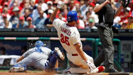 Philadelphia Phillies starting pitcher Cole Hamels (35) scores as Los Angeles Dodgers catcher Matt Treanor looks for the ball in the third inning of a baseball game, Thursday, June 7, 2012, in Philadelphia. (AP Photo/H. Rumph Jr)