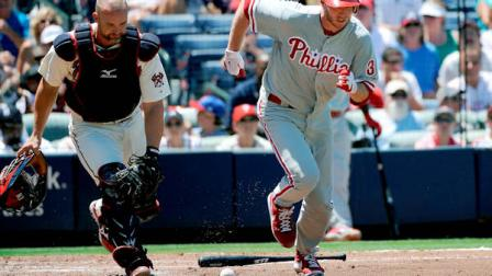 Atlanta Braves catcher David Ross watches a bunt by Philadelphia Phillies Roy Halladay roll foul during the third inning of their baseball game, Sunday, July 29, 2012, in Atlanta. (AP Photo/David Tulis)