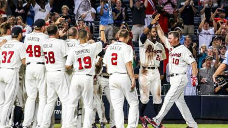 Atlanta Braves Chipper Jones (10) celebrates his three-run, walk-off home run in the ninth inning of a baseball game against the Philadelphia Phillies, Sunday, Sept. 2, 2012, in Atlanta. The Braves won 8-7. (AP Photo/Daniel Shirey)
