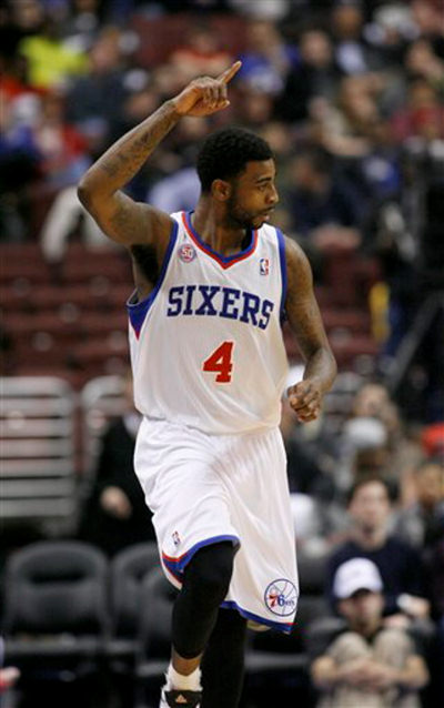 Philadelphia 76ers' Dorell Wright (4) celebrates after he scored against Golden State Warriors in the first half of an NBA basketball game on Saturday, March 2, 2013, in Philadelphia. (AP Photo/H. Rumph Jr)