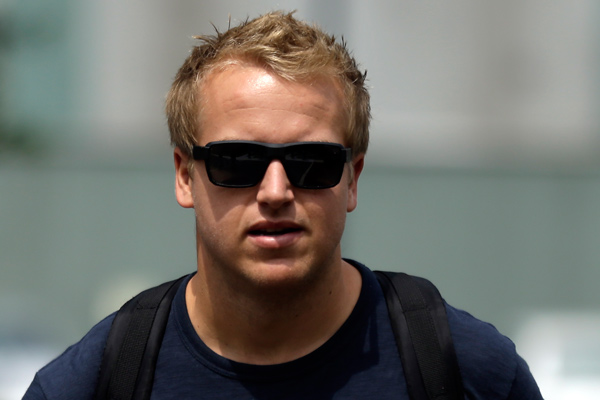 Philadelphia Eagles rookie quarterback Matt Barkley arrives at the NFL football team's training camp in Philadelphia, Monday, July 22, 2013. (AP Photo/Matt Rourke)