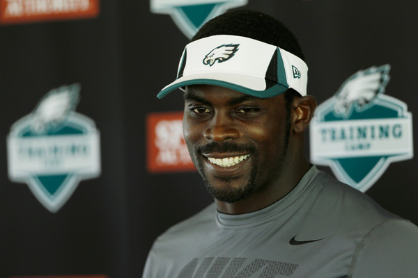 Philadelphia Eagles' Michael Vick speaks with reporters after a workout at NFL football training camp in Philadelphia, Tuesday, July 23, 2013. (AP Photo/Matt Rourke)