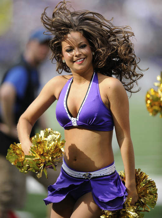 A Baltimore Ravens cheerleader performs during the first half of an NFL football game against the Buffalo Bills in Baltimore, Sunday, Oct. 24, 2010. &#40;AP Photo&#47;Nick Wass&#41; <span class=meta>(AP Photo)</span>
